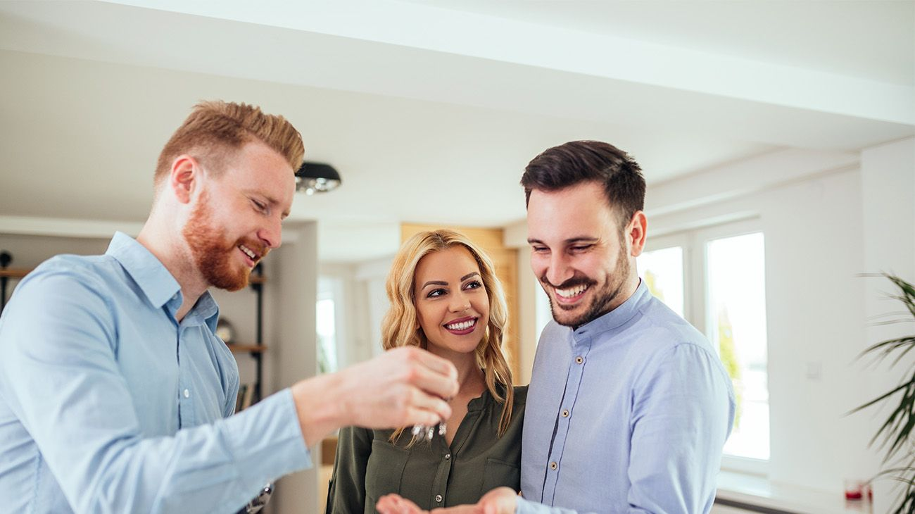 Realtor handing over the keys to new homeowners