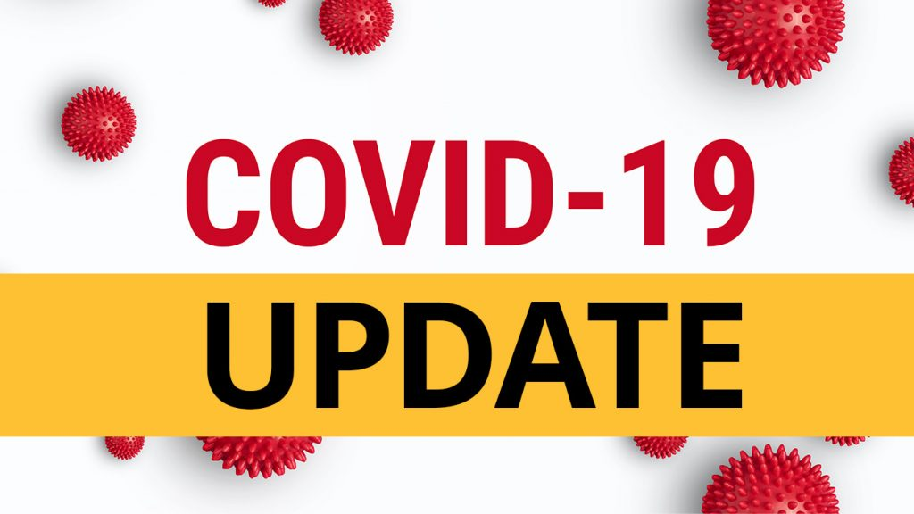 """""""COVID-19 Update"""" text over red virus cells"""