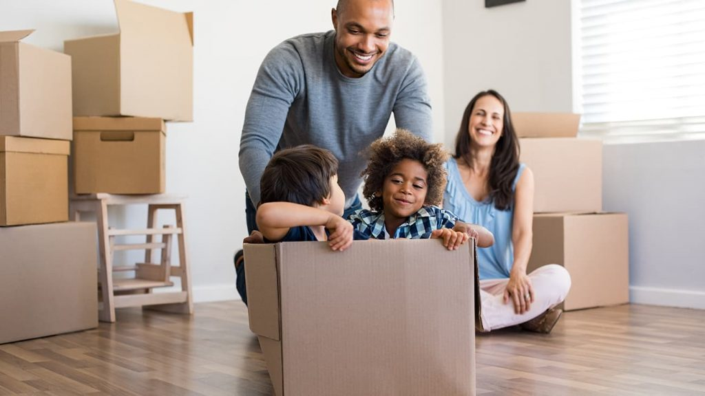 Young family having fun on moving day
