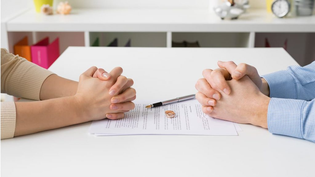 Couple reviewing divorce papers