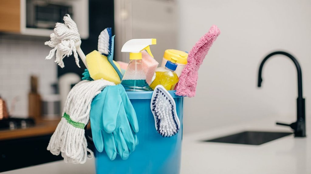 Cleaning supply bucket on counter