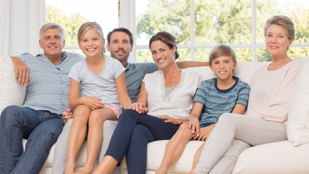 Happy family sitting on couch