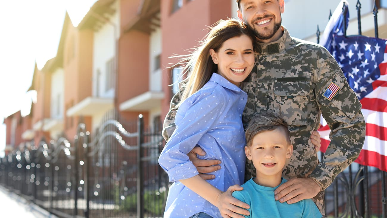 Military family outside house